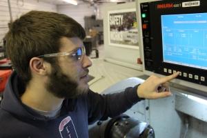 Tech at CNC panel